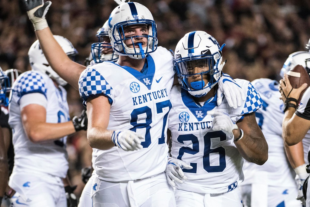 . Kentucky tight end C.J. Conrad (87) and running back Benny Snell Jr. (26) celebrate a touchdown during the first half of an NCAA college football game Saturday, Sept. 16, 2017, in Columbia, S.C. Kentucky defeated South Carolina 23-13. (AP Photo/Sean Rayford)