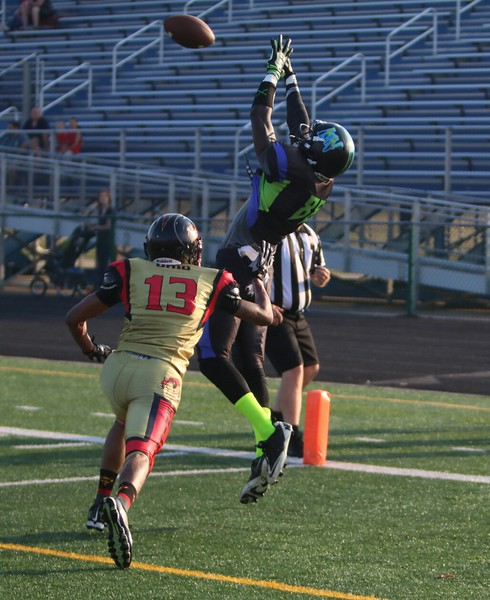 The Nightmares' James Washington leaps for a touchdown catch.  Amanda K. Rundle -- The Morning Journal