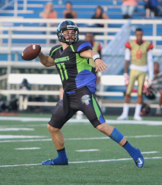 Nightmares quarterback Cody Schuster looks for a receiver.  Amanda K. Rundle -- The Morning Journal