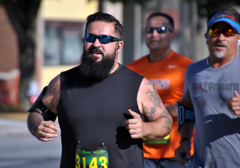 Jon Behm - The Morning Journal<br> Dan Ketcham makes his was down Broadway at the start of the eighth annual Journal Jog on July 30.