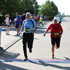 Randy Meyers - The Morning Journal<br> Runners John Paul, left, and Teresa Starkey cross the finish line at the eighth annual Journal Jog on July 30.