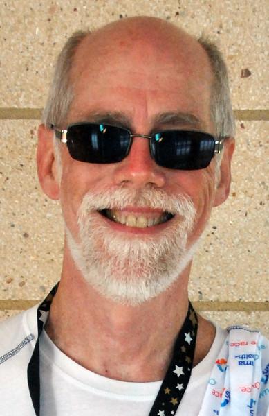 Jon Behm - The Morning Journal<br> Men's 55-59 age group winner, Jay Ogan.