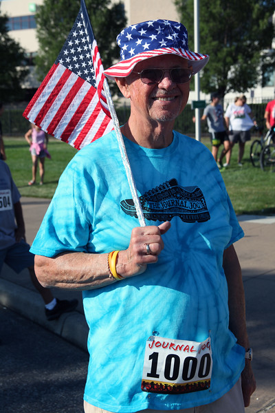 Randy Meyers - The Morning Journal<br> Retired Air Force veteran Ray Asik waits for the start of the 3k walk at the Black River Landing on July 30.