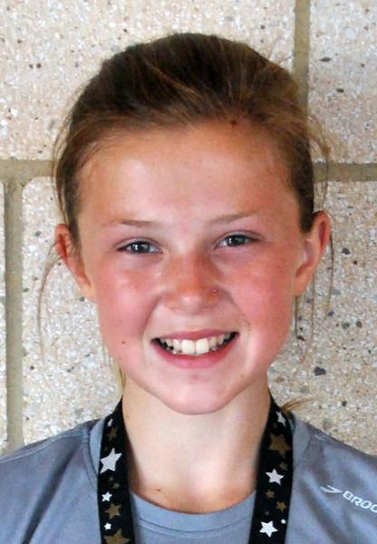Jon Behm - The Morning Journal<br> Women's first overall finisher, Savannah Dennison.
