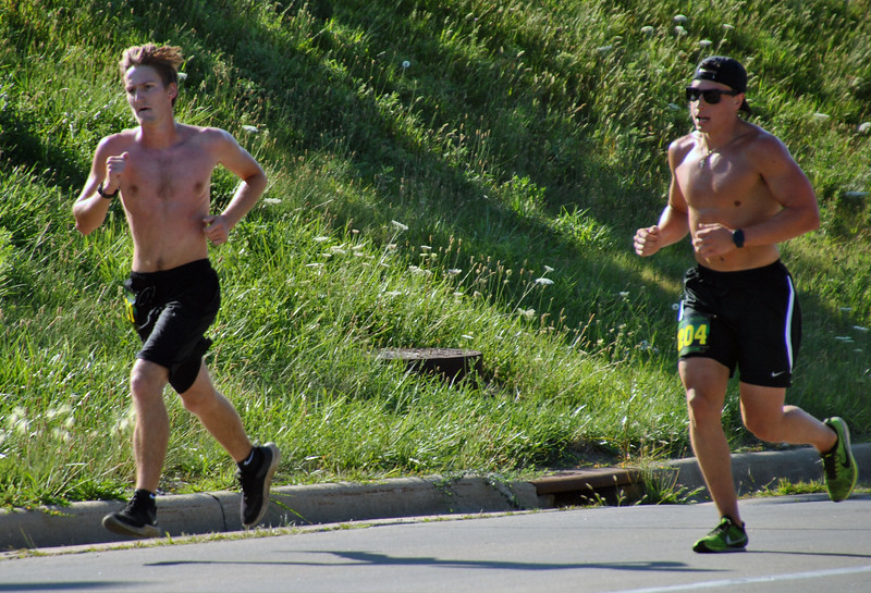 Jon Behm - The Morning Journal<br> 2017 Journal Jog winner Sam McClelland, left, holds a narrow lead over Alex Radanovich, who finished second overall. McClelland won the race with a time of 18:02.7 during the eighth annual Journal Jog on July 30.