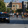 Jon Behm - The Morning Journal<br> A police escort leads the eighth annual Journal Jog on July 30 as runners make their way south on Broadway.