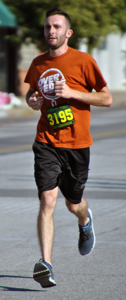 Jon Behm - The Morning Journal<br> Alan Lewis, of Lorain, works his way down Broadway during the eighth annual Journal Jog on July 30.