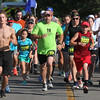 Randy Meyers - The Morning Journal<br> Runners start the eighth annual Journal Jog at the Black River Landing on July 30.