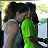 Jon Behm - The Morning Journal<br> Runners check their results following the eighth annual Journal Jog on July 30.