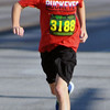 Jon Behm - The Morning Journal<br> Billy Dennison takes a big stride during the eighth annual Journal Jog on July 30.