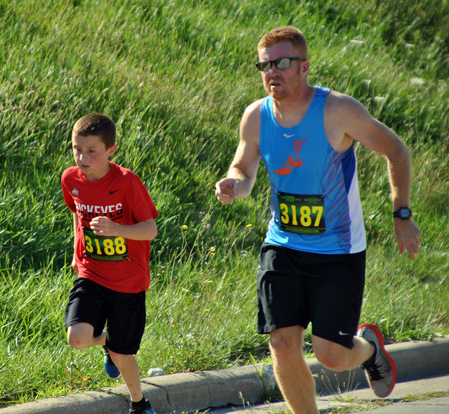 Jon Behm - The Morning Journal<br> Billy, left, and Bill Dennison hit the home stretch during the eighth annual Journal Jog on July 30.
