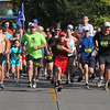 Randy Meyers - The Morning Journal<br> Runners at the start of the Journal Jog 5k race on July 30 at the Black River Landing in Lorain.
