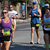 Jon Behm - The Morning Journal<br> Jennifer McPherson, left, leads a pack of runners on Broadway during the eighth annual Journal Jog on July 30.