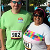 Randy Meyers - The Morning Journal<br> Sharon Pearson and A.J. Clonts await the start of the Journal Jog 3k walk on Sunday at the Black River Landing.