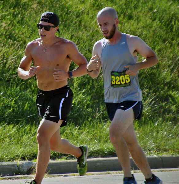 Jon Behm - The Morning Journal<br> Alex Radanovich, left, and Creighton Jensen battle for second down the home stretch during the eighth annual Journal Jog on July 30.