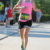 Randy Meyers - The Morning Journal<br> Women's winner Savannah Dennison, of Mentor, takes a large stride accross the finish line on July 30. It is the second time Dennison has won the Journal Jog.