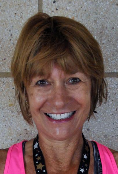 Jon Behm - The Morning Journal<br> Women's 55-59 age group winner, Janet Karpinski.