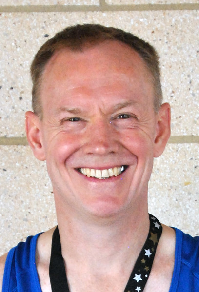 Jon Behm - The Morning Journal<br> Men's 50-54 age group winner, Keith Tolfrey.