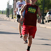 Randy Meyers - The Morning Journal<br> Mark Miller crosses the finish line at the eighth annual Journal Jog on July 30.
