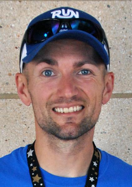 Jon Behm - The Morning Journal<br> Men's 35-39 age group winner, Jeff Edwards.