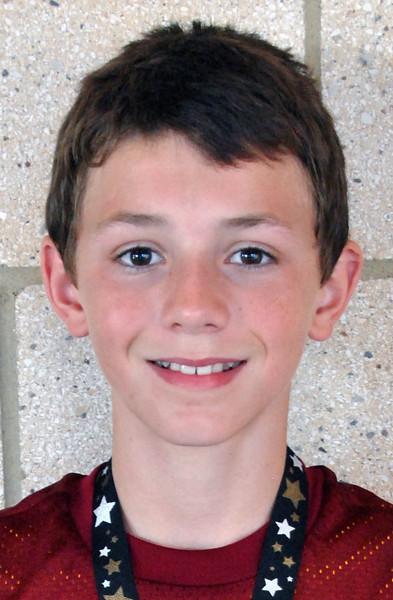 Jon Behm - The Morning Journal<br> Men's 12-and-under age group winner, Mark Miller.