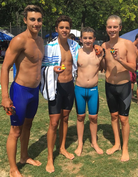 Courtesy Katie Tuohey South Euclid/Lyndhurst Sea Monkey team members, from left, Matt Vanone, Christian King, Hunter Forsyth and Brian Tuohey won the medley and free relays on July 30 at the Suburban Swim League championships in Mentor.