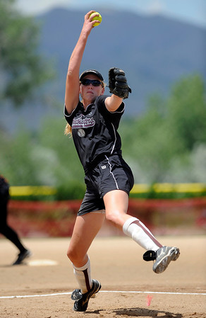 Batbusters Gold pitcher Kristin Cullen winds up to pitch against the Beverly Bandits during the Independence Day softball tournament at Stazio Fields in Boulder, Colorado July 3, 2011.  CAMERA/Mark Leffingwell