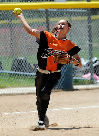 Beverly Bandits' Sammy Marshal makes the throw to first for the out after stoping a ground ball against the Batbusters Gold during the Independence Day softball tournament at Stazio Fields in Boulder, Colorado July 3, 2011.  CAMERA/Mark Leffingwell
