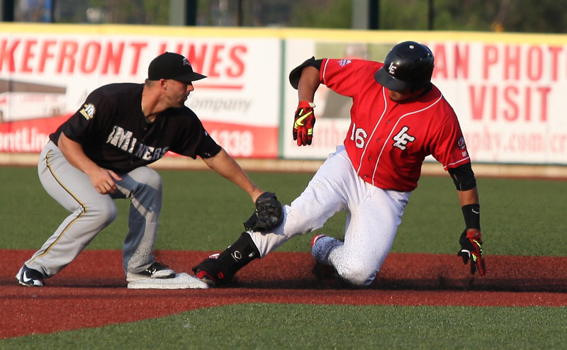 Jose Barraza of the Crushers slides in safely at second just before the tag by Shane Kennedy of the Southern Illinois Miners on Aug. 4. Randy Meyers -- The Morning Journal
