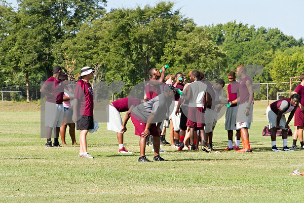 Photo by Shannon Wilson / Tyler Morning Telegraph Whitehouse football players take a water break during morning practice on Monday.