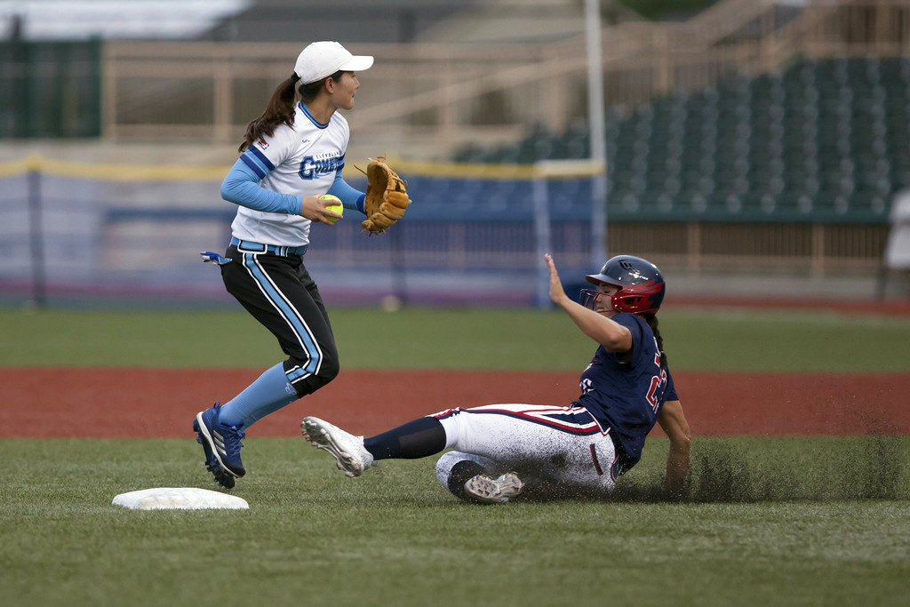 . Jen Forbus - The Morning Journal Cleveland short stop, Jiang Xinyue makes the out at second and turns to look for a possible double play at first.