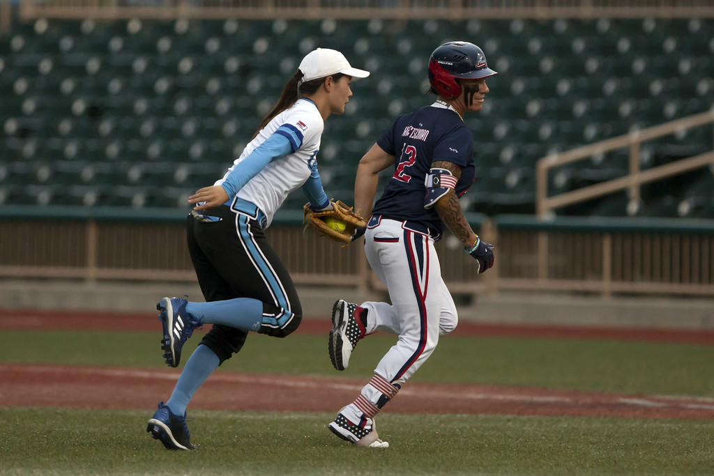 . Jen Forbus - The Morning Journal Cleveland second baseman Xie Yue tags USSSA Pride baserunner Kelly Kretschman out in a rundown.