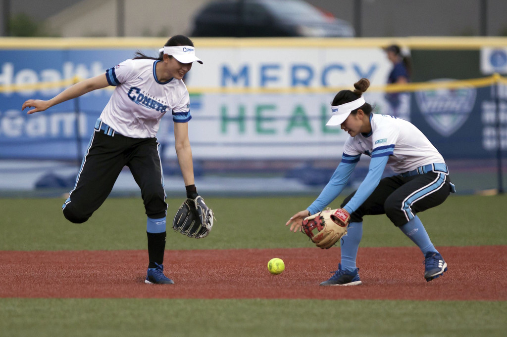 . Jen Forbus - The Morning Journal  Cleveland second baseman, Xie Yue (right) and right fielder, Lu Yao, scramble for the ball.
