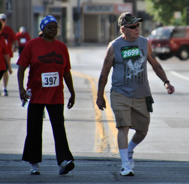 Jon Behm - The Morning Journal<br /> Eddie Hendershot, right, participates in the 3k walk during the 7th annual Journal Jog on Aug. 7.