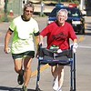 Amanda K. Rundle - The Morning Journal<br /> Susan Thayer, left, cheers Cynthia Farrell, of Vermilion, as she races down the home stretch of the 7th annual Journal Jog on Aug. 7.