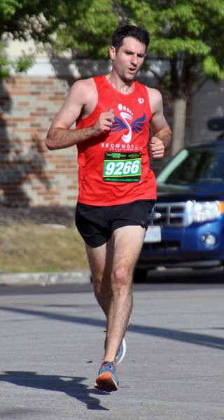 Jon Behm - The Morning Journal<br /> Mark Grogan, of Bay Village, turns the corner at City Hall and heads into the home stretch at the 7th annual Journal Jog on Aug. 7. Grogan won the race.