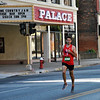 Jon Behm - The Morning Journal<br /> Mark Grogan, of Bay Village, leads all runners past the Palace Theater at the 7th annual Journal Jog on Aug. 7. Grogan won the race.