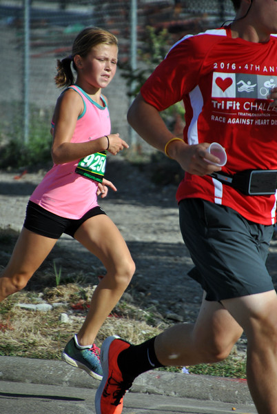 Jon Behm - The Morning Journal<br /> Women's winner Savannah Dennison, of Mentor, works to keep pace with overall third-place runner Alex Radanovich, of Lorain, in the home stretch of the 7th annual Journal Jog on Aug. 7.