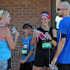 Jon Behm - The Morning Journal<br /> Runners chat following the 7th annual Journal Jog at the Black River Landing on Aug. 7.