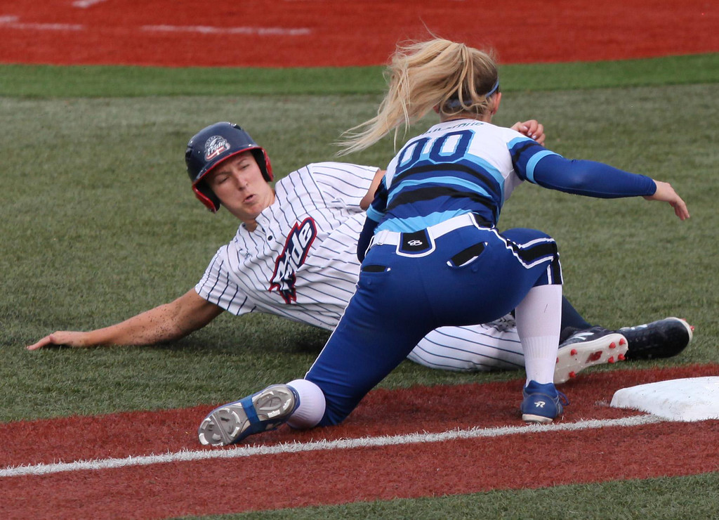. Randy Meyers - The Morning Journal Shelby Pendley of the USSSA Pride  is tagged out at third by Jenna Lilley of the Cleveland Comets on  Wednesday