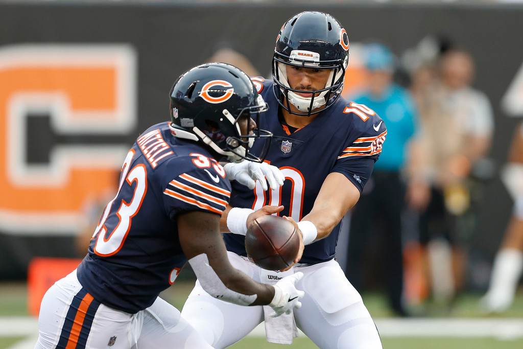 . Chicago Bears quarterback Mitchell Trubisky (10) hands off the ball to running back Taquan Mizzell (33) in the first half of an NFL preseason football game against the Cincinnati Bengals, Thursday, Aug. 9, 2018, in Cincinnati. (AP Photo/Gary Landers)