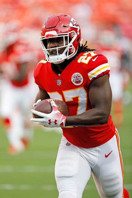 . Kansas City Chiefs running back Kareem Hunt (27) warms up before an NFL preseason football game against the Houston Texans in Kansas City, Mo., Thursday, Aug. 9, 2018. (AP Photo/Colin E. Braley)