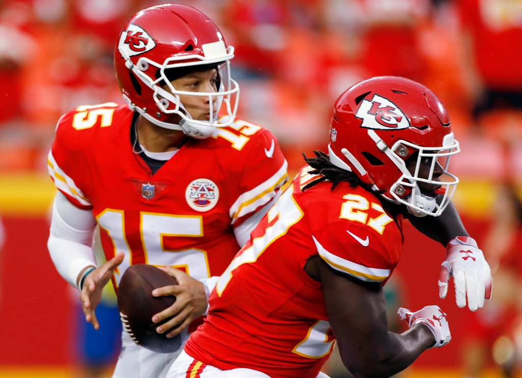. Kansas City Chiefs quarterback Patrick Mahomes (15) looks for a receiver, next to running back Kareem Hunt (27) during the first half of an NFL preseason football game against the Houston Texans in Kansas City, Mo., Thursday, Aug. 9, 2018. (AP Photo/Colin E. Braley)