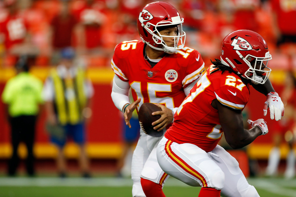 . Kansas City Chiefs quarterback Patrick Mahomes (15) looks for a receiver behind running back Kareem Hunt (27) during the first half of an NFL preseason football game against the Houston Texans in Kansas City, Mo., Thursday, Aug. 9, 2018. (AP Photo/Colin E. Braley)