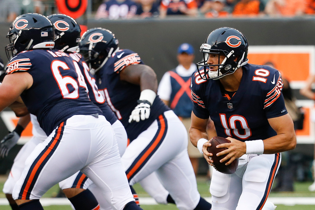 . Chicago Bears quarterback Mitchell Trubisky looks to throw on the run in the first half of an NFL preseason football game against the Cincinnati Bengals, Thursday, Aug. 9, 2018, in Cincinnati. (AP Photo/Frank Victores)