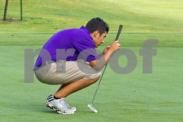 Photo by Shannon Wilson / Tyler Morning Telegraph Philip White sets up his putt on the first hole putting green during the 1st Annual Junior Golf Championship at the Pine Springs Golf Club in Tyler.