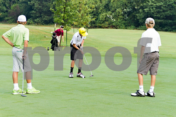 Photo by Shannon Wilson / Tyler Morning Telegraph Darrin Kingsley (12) putts on the first hole putting green while Will Harrison (13), left, and Skyler Trevino (11) waits for their turns during the 1st Annual Junior Golf Championship at the Pine Springs Golf Club in Tyler.