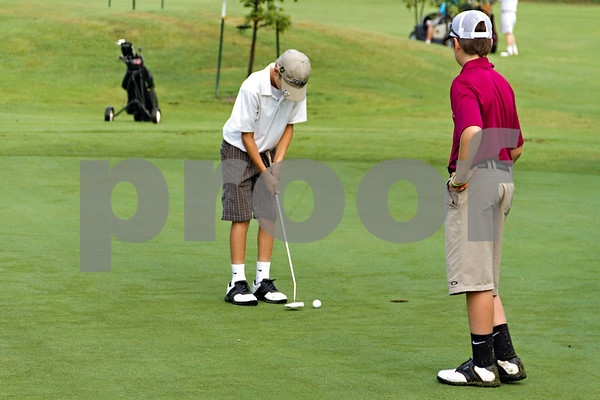 Photo by Shannon Wilson / Tyler Morning Telegraph Skyler Trevino (11) putts on the first hole putting green while Marty Foster (12) waits for his turn during the 1st Annual Junior Golf Championship at the Pine Springs Golf Club in Tyler.