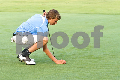 Photo by Shannon Wilson / Tyler Morning Telegraph Andrew Brown sets up his putt on the first hole putting green during the 1st Annual Junior Golf Championship at the Pine Springs Golf Club in Tyler.
