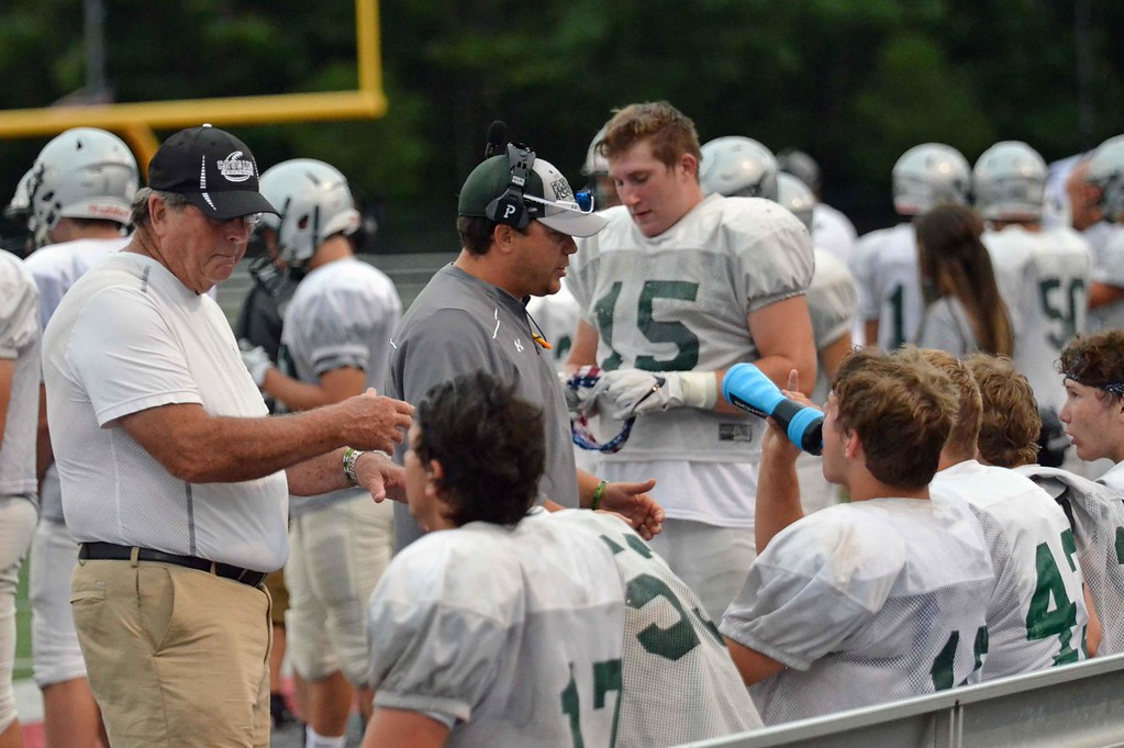 . Paul DiCicco - The News-Herald  Action from a scrimmage between Lake Catholic Cougars and the Madison Blue Streaks at Mentor High School on Aug 16, 2018.